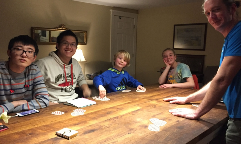 Henshaw family and students playing board game