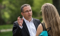 President Adam Weinberg talking to a student