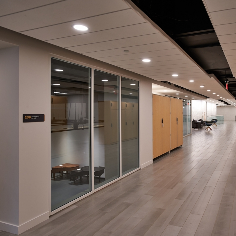 View of glass windows of rehearsal space, and hallway and locker space at the Eisner Center for the Performing Arts