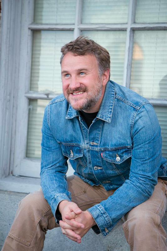 Dan Fiden sitting outside smiling.
