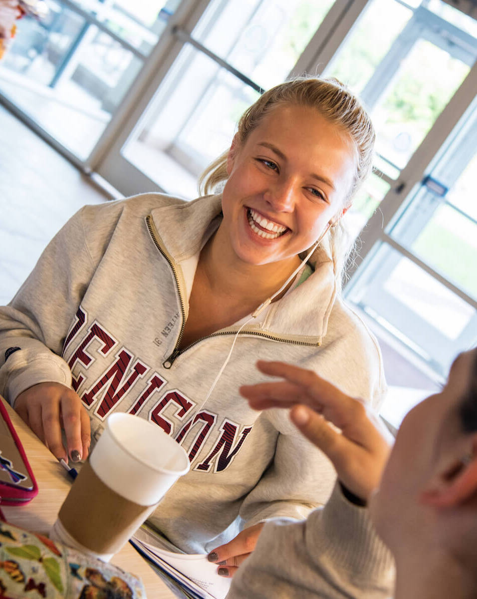 Students laughing at Slayter Hall